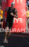 Andy Potts first out of the water at the Ironman…