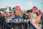An age grouper smiles at the Ironman 70.3 Miami in…