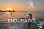 Age grouper jumping into the water for his start wave…