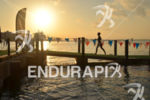 Athelete finishes swim course at the Ironman 70.3 Miami in…