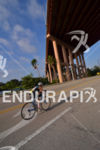 Cycling under the bridge at the Ironman 70.3 Miami in…