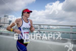 Leanda Cave runs for her victory at the Ironman 70.3…