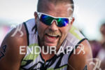 Ian Mikelson catches a breather at the finish line after…