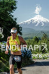 Luke McKenzie from Australia runs with the Villarrica Volcano on…