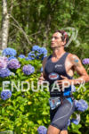 Guilherme Manocchio running among the amazing flowers at the Ironman…