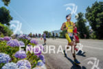 Running among flowers at the Ironman 70.3 Pucon in Pucon,…