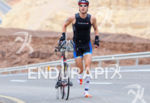 Half distance second Anders Stampe (DEN) running with his bike's…
