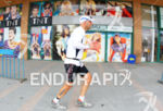 Triathlete running front of mode's shop