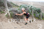 Lauren Goss climbs sand stairs at the 2013 Escape from…