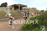 Athletes run through the scenic course at the 2013 Escape…