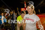 Amateur female triathlete beig body marked prior to the race…