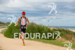 Chris Legh on run at the Ironman Asia-Pacific Championship on…