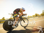 Craig Alexander on bike at the Ironman Asia-Pacific Championship on…