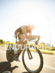 Craig Alexander on bike at the Ironman Asia-Pacific Championshipon March…