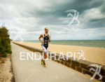 Jordan Rapp on run at the Ironman Asia-Pacific Championship on…