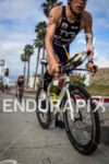 Andy Potts hammers uphill on biek at the  Ironman 70.3…