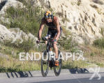 Matty Reed, USA, on the bike at the 2013 Ironman…