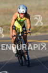 Leslie Paterson climbs on bike at the 2013 Ironman 70.3…
