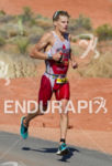 Brent Mcmahon runs through Pioneer Park at the 2013 Ironman…
