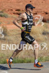 Andy Potts runs through Pioneer Park at the 2013 Ironman…