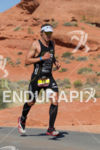 TJ Tollakson runs through Pioneer Park atthe 2013 Ironman 70.3…