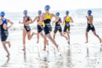 Triathletes running into the water  at 2013 Joao Pessoa ITU…