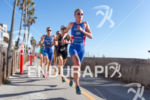 Non Stanford (GBR) runs along the beach at the 2013…
