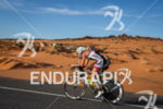 Uli Bromme on bike at the 2013 Ironman 70.3 St.…