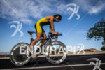 Mathew Pellow on bike at the 2013 Ironman 70.3 St.…