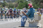 A race fan greets the peloton during stage two of…