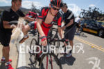 Tejay van Garderen is helped on to a spare bike…