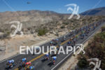 The peloton descends toward Palm Desert in heat exceeding 100…