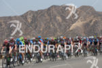 The peloton rides away from the hills of Santa Clarita…