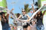 Kristin Moeller celebrates at the finish of the 2013 Ironman…
