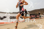 Lukas Verzbicas (USA) runs along the beach to start the…
