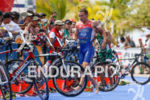 Artem Parienko (RUS) heads into transition to start the bike…