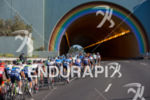 The peloton enters the famous rainbow tunnel leading into Marin…