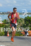 Timothy O'Donnel faces the tough Canasvieiras climb at 2013 Ironman…