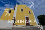 Age grouper running thru the Canasvieiras Church at 2013 Ironman…