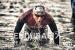 A pro triathlete exits the on the swim at the…