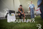 TJ Tollakson during the bike to run transition at Ironman…