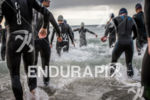 Athletes run into Douglas Bay, to start the TT Triathlon…