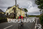 Athlete on bike at the TT Triathlon on the Isle…