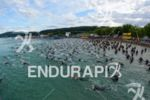 swim start of the Ironman Austria in Klagenfurt, Austria on…
