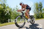 Maik Twelsiek on the bike at the Ironman Austria in…