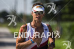 Blake Becker running at the 2013 Ironman Muncie 70.3 on…