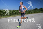 Tyler Butterfield running at the 2013 Ironman Muncie 70.3 on…