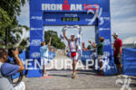 Martin Jensen crossing the finish line at the 2013 Ironman…