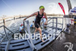 CAROLINE GREGORY exiting swim at the 2013 Ironman Louisville on…
