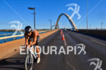 Amateur triathlete riding over the JK bridge at the 2013…